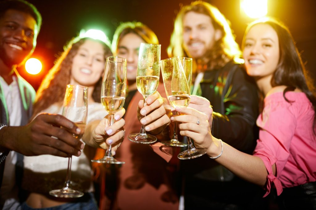 Drinking champagne at party in nightclub